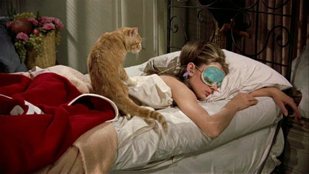 audrey-hepburn-as-holy-golightly-sleeping-breakfast-at-tiffanys