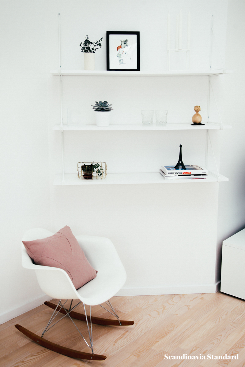 The White Room - Christina & Ulrich's Østerbro Apartment - Interiors - Rocking Chair & White Shelves | Scandinavia Standard