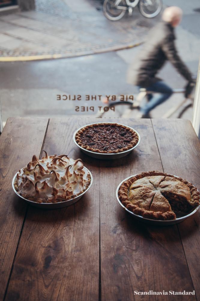 Man Riding Bike Past Pie - American Pie Company - Copenhagen   Must See   Scandinavia Standard